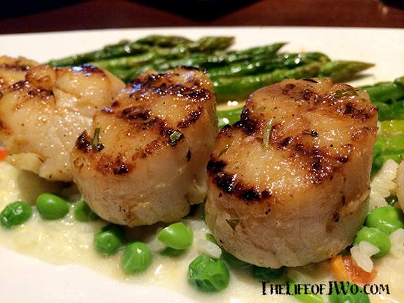 Caramelized Grilled Sea Scallops with creamy lemon risotto, English peas, roasted asparagus.